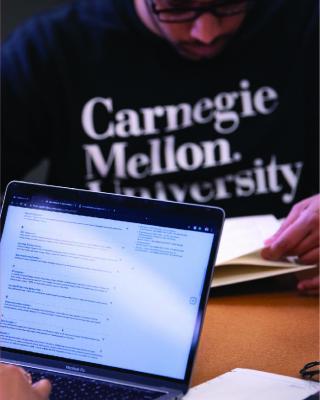 Image of CMU student using laptop.