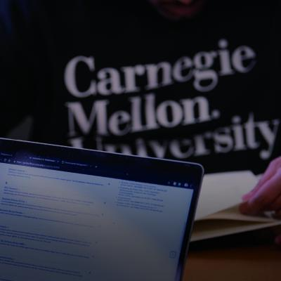 Image of CMU students at computer.
