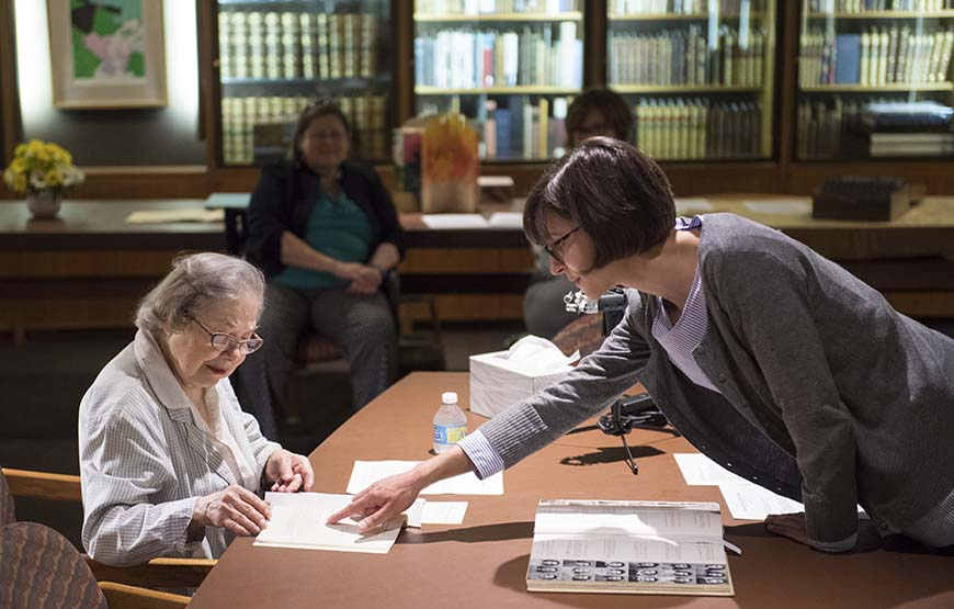 Anita Newell and Kate Barbera viewing archival materials
